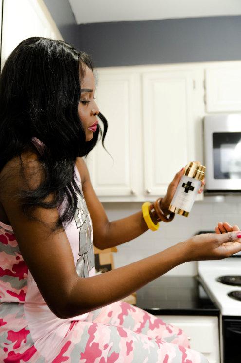 women model sprinkling her hand