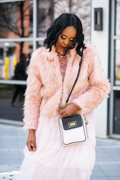 woman wearing soft pink light fur coat